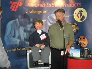 Chip Martin working at a TLP tradeshow booth.