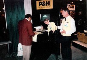 Dale and Chip at a P&H Tradeshow booth